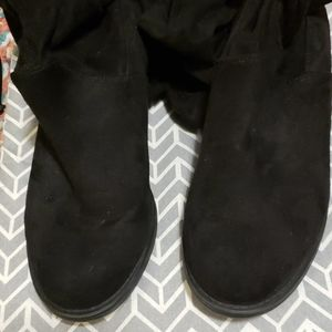 Tall black slouch boots